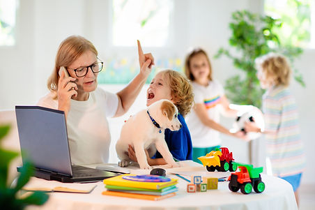 Mother working from home with kids. Home