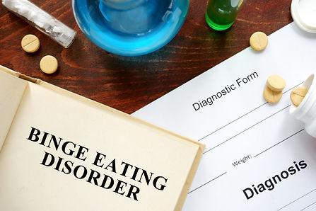 binge eating disorder  written on book w