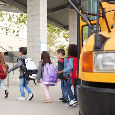 elementary-school-kids-arrive-at-school-