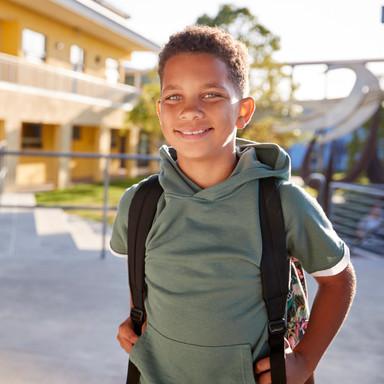 portrait-of-smiling-elementary-school-bo