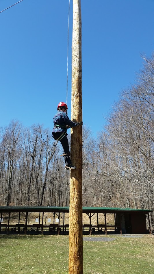 Climbing a Spar Pole at Camp Minsi