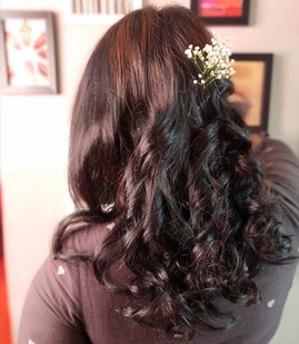 Open hair do with curls close up