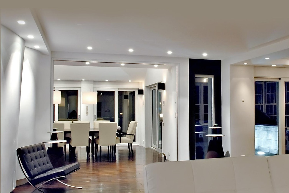 Natural lighting in this contemporary colonial home featuring Lutron lighting