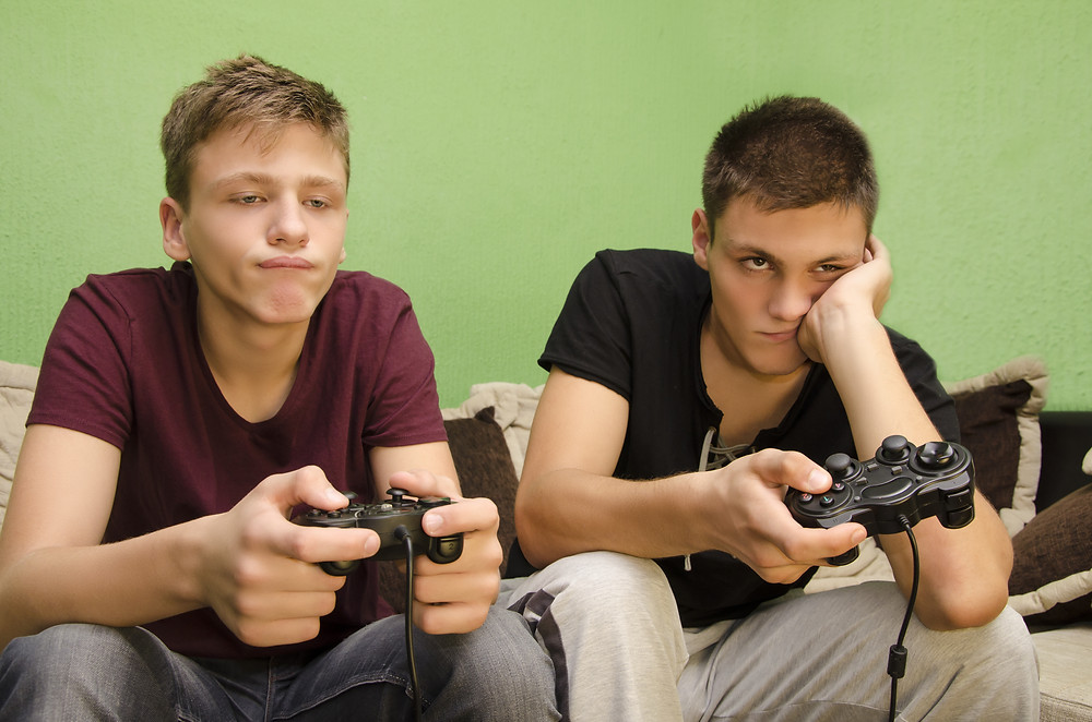 bored brothers playing video games