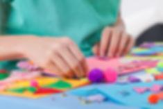 Little boy making artworks on art lesson