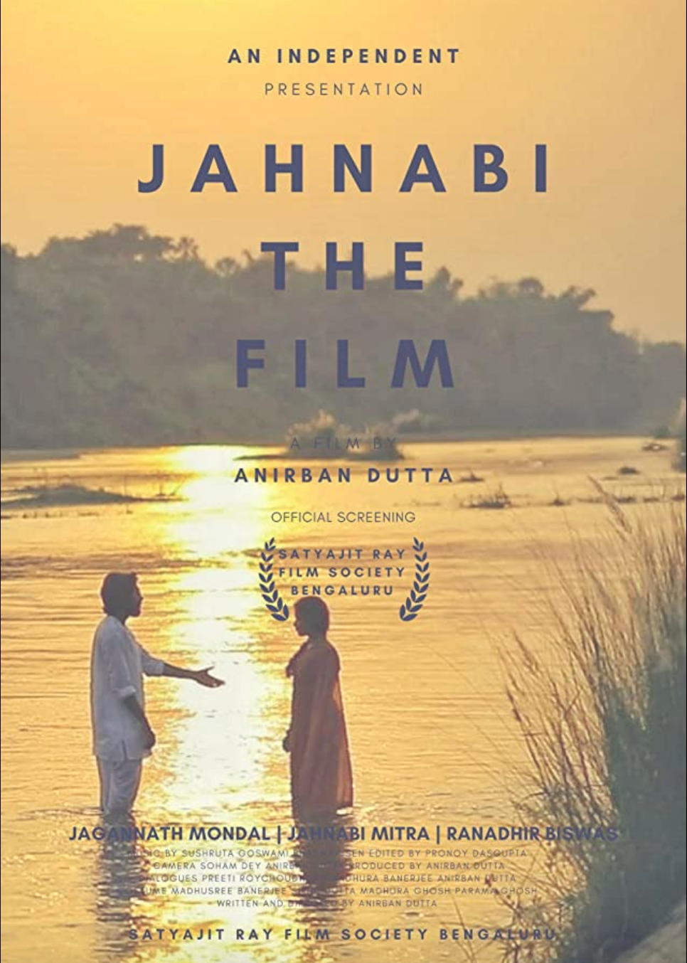 Poster of the film depicting the two main characters standing in the river Ganges, the water brightly illuminated by the sunset.