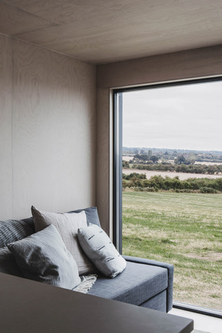 Ayr_Micro_Cabin_Interior_with_Sofa_and_View