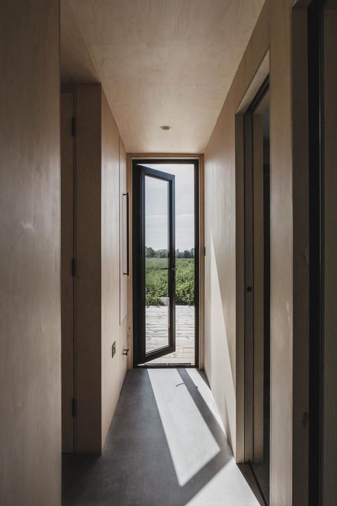 Ayr_Family_Cabin_Interior_Hallway_with_Glass_Door