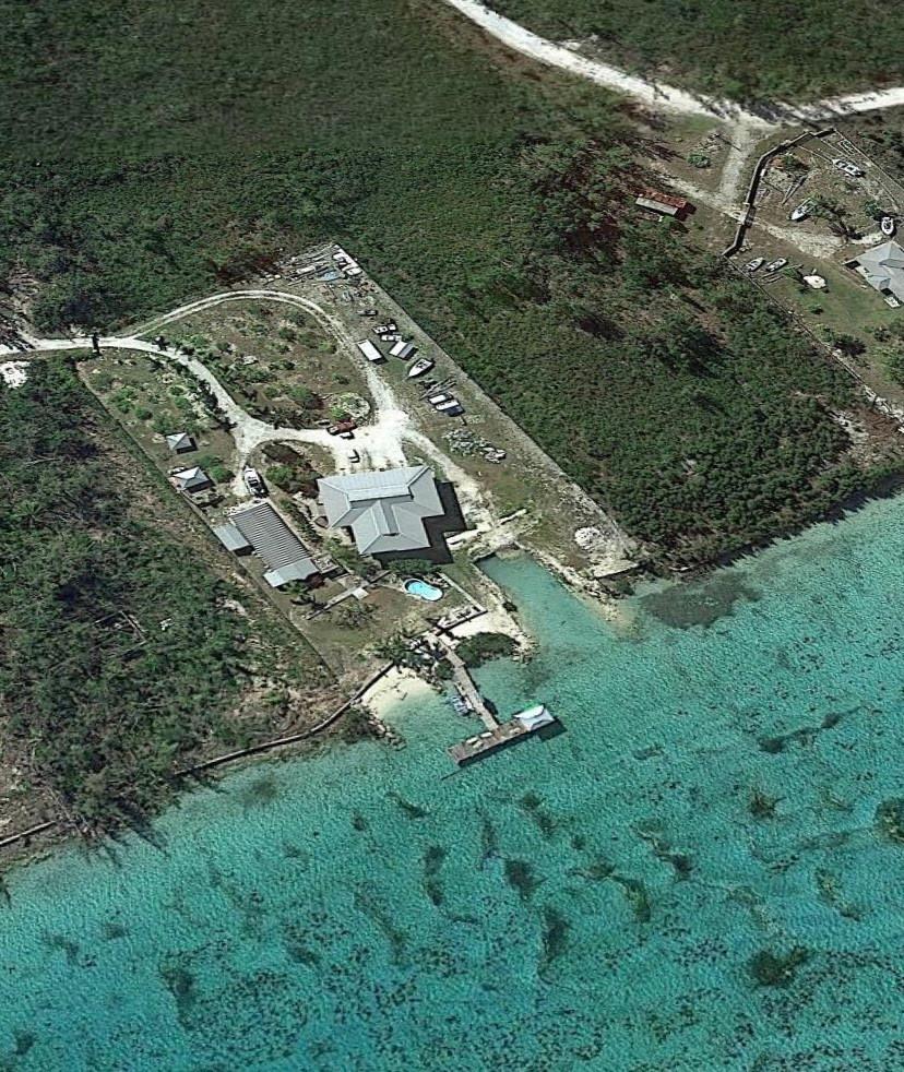 aerial shot of creekside property