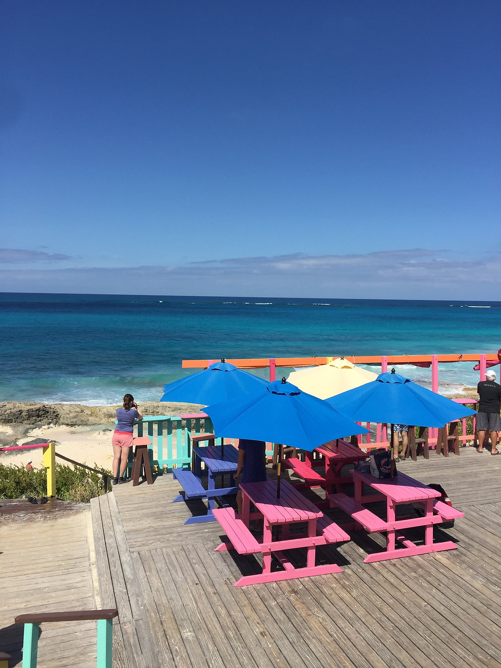 Vibrantly painted picnic tables at Nipper's Beach Bar & Grill in Great Guana Cay, Abaco in The Bahamas