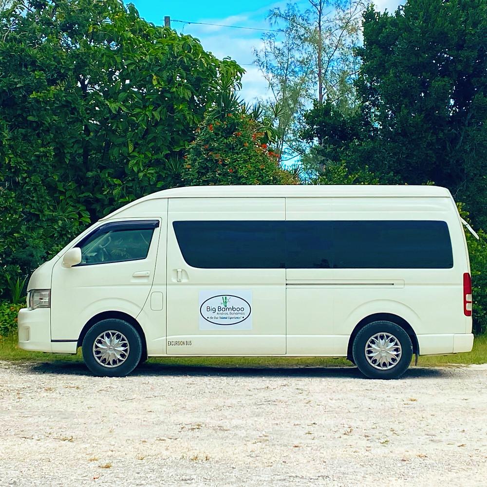 Shuttle bus with Big Bamboo Bahamas logo on its door