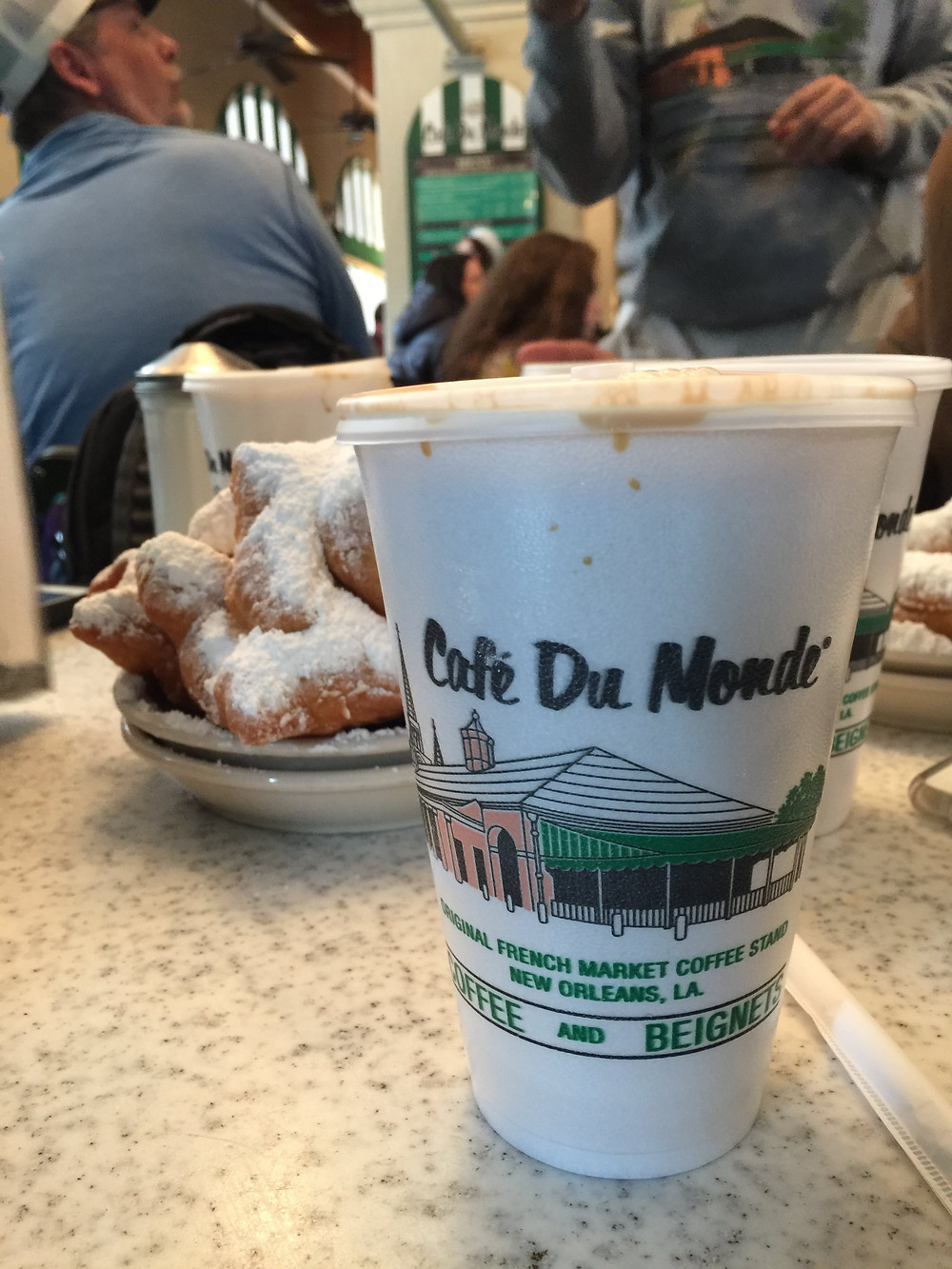 Cafe du Monde styrofoam cup and beignets