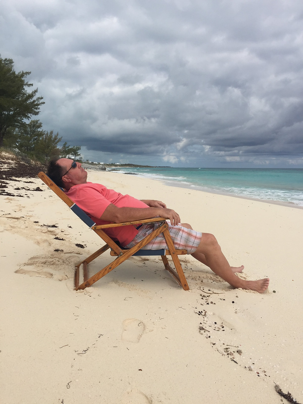 Relaxing on a chair right on the beach.