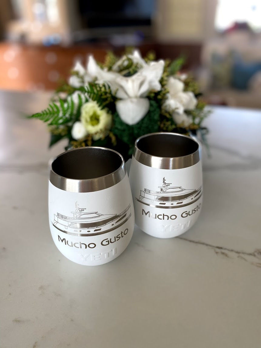 Two Yeti wine tumblers with Mucho Gusto logo