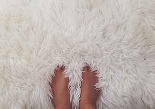 White Fur Rug with Both Feet