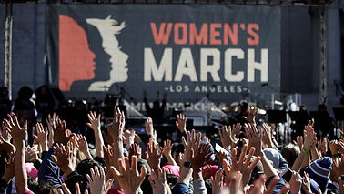 Participants raising hands at the Women's March in Los Angeles
