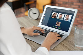 Woman having video chat with colleagues