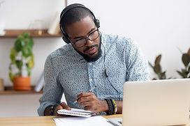 Focused african business man in headphon