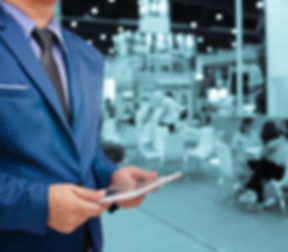 business man holding tablet with blurry