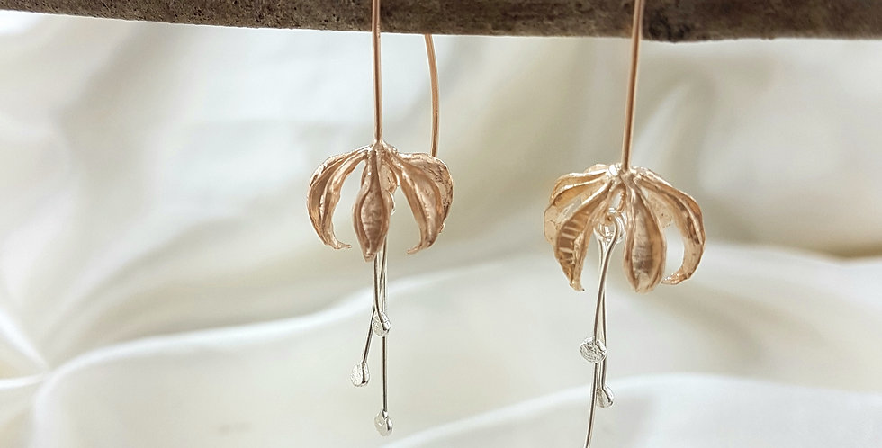 Rose gold dangly lily flower earrings