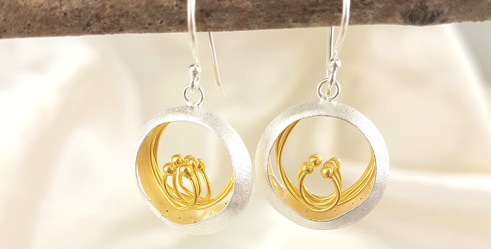 Gold and sterling silver circle earrings