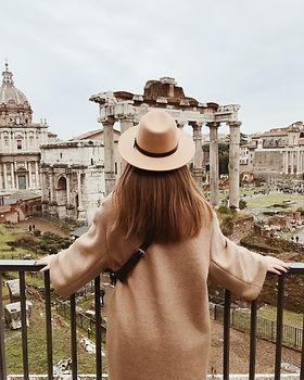 woman-in-beige-sun-hat-standing-on-balco