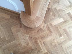 Solid oak parquet cut around step