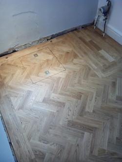 Hatch in oak parquet floor