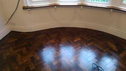 Pine dark stained parquet floor