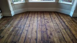 Dark stained pine floorboards
