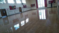 School hall lacquered maple floor