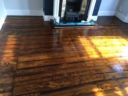 Dark pine floorboards