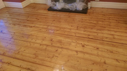 Lacquered pine floorboards