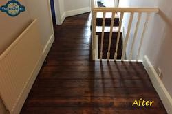 Dark stained floorboards