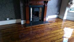Pine dark stained floorboards