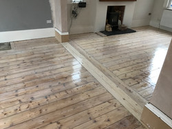 White tinted pine floorboards