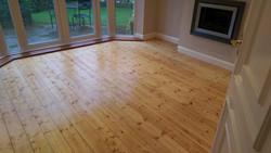 Restored pine floorboards
