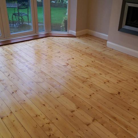 Varnished pine floorboards