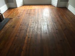 Matt dark stained floorboards