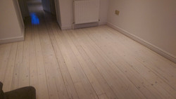 White lacquered floorboards