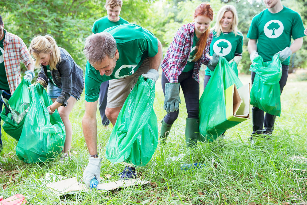 Volunteers cleaning a public park of litter and trash