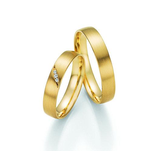Paar Eheringe aus Gelbgold oder Weißgold mit Brillan