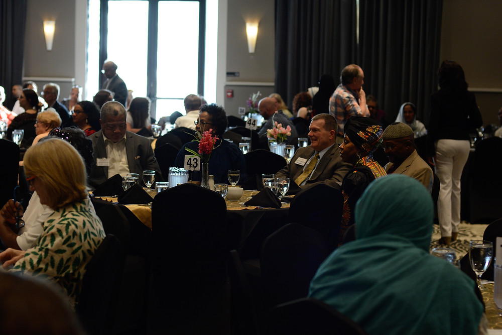 Attendees of the interfaith dinner sit and listen to speakers. Photo by Azeem Sikander