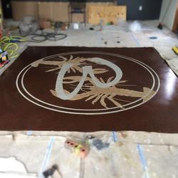 Compound Etched Logo done by Patriot Industries Concrete. Innovative techniques for Decorative Concr