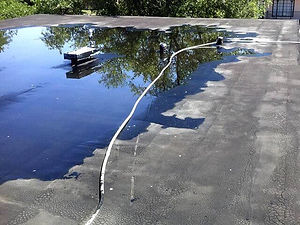 Ponding-Water-on-a-Flat-Roof.jpg