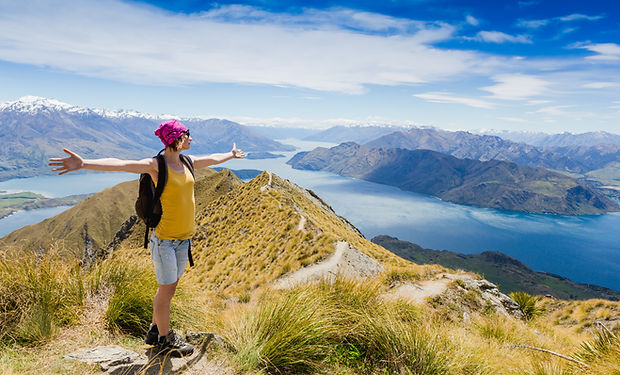 Woman Traveler with Backpack hiking in M