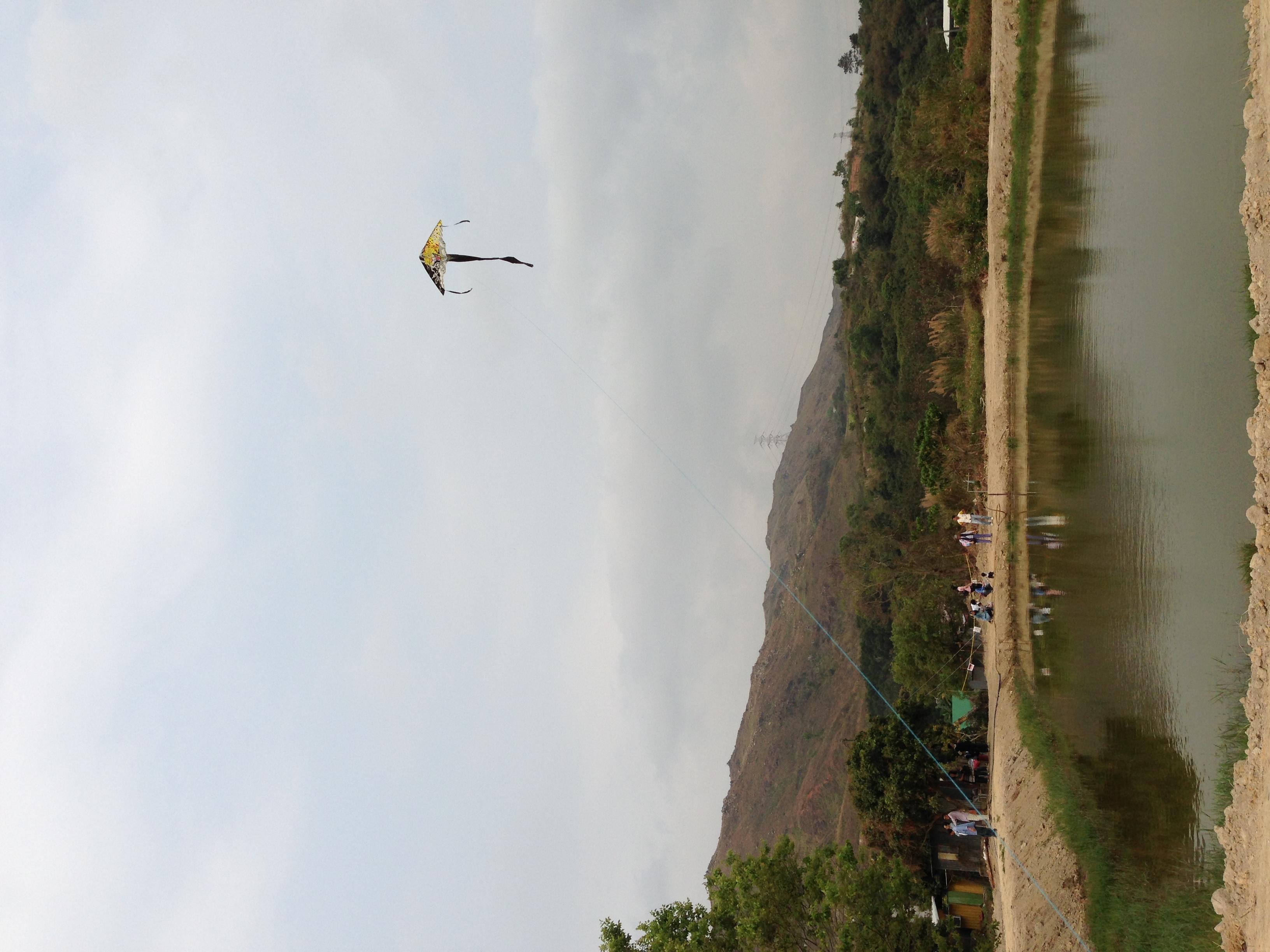Fly a kite by the pond.