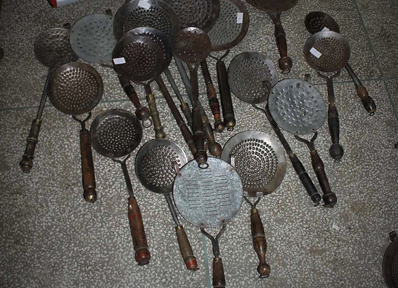 small iron spoon perforated