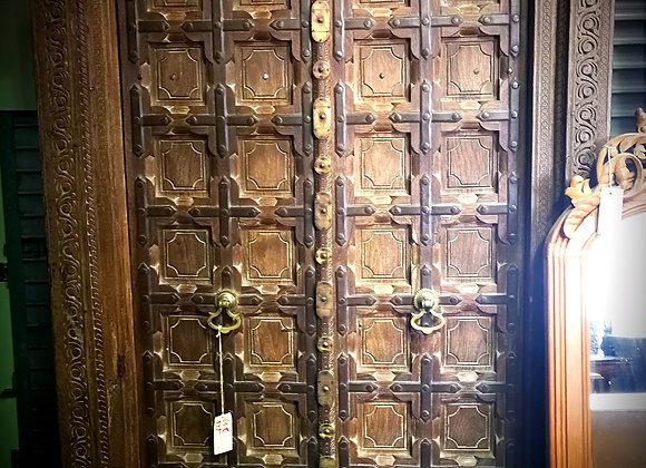 Heavily carved, Brass and iron bound teak door
