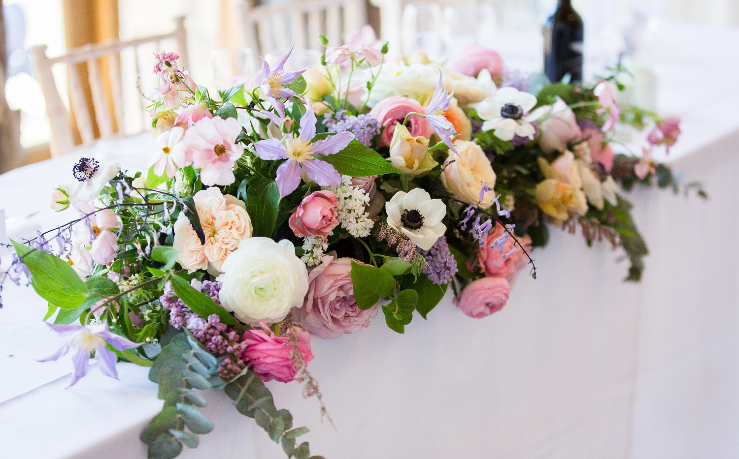 Pink and lilac wedding table flowers